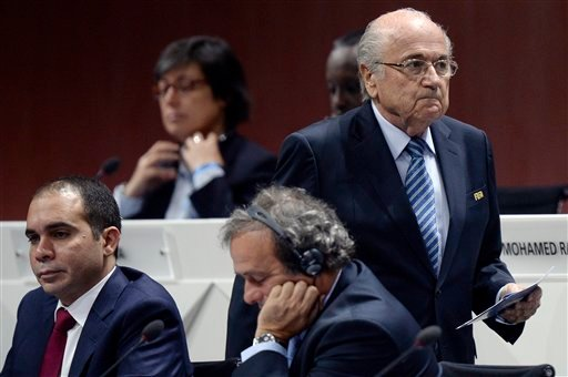 FIFA president Joseph S. Blatter, right, walks past Prince Ali bin al-Hussein, left, and UEFA President Michel Platini, center, during the 65th FIFA Congress held at the Hallenstadion in Zurich, Switzerland, Friday, May 29, 2015, where he will run for re-