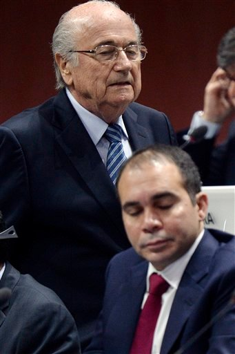 FIFA president Joseph S. Blatter, left, walks past Prince Ali bin al-Hussein, right, during the 65th FIFA Congress held at the Hallenstadion in Zurich, Switzerland, Friday, May 29, 2015, where Blatter runs for re-election. (Walter Bieri/Keystone via AP)