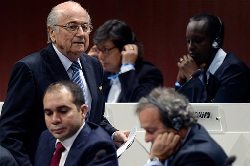FIFA president Joseph S. Blatter, left, walks past Prince Ali bin al-Hussein, left, and UEFA President Michel Platini, center, during the 65th FIFA Congress held at the Hallenstadion in Zurich, Switzerland, Friday, May 29, 2015, where he will run for re-e