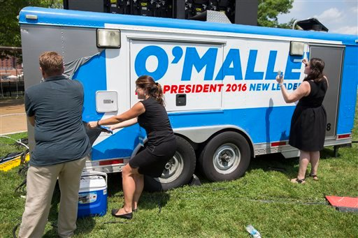 Workers remove a campaign sign from a truck after an event with former Maryland Gov. Martin O'Malley to announce that he is entering the Democratic presidential race, on Saturday, May 30, 2015, in Baltimore. O'Malley on Saturday joined the Democratic pres