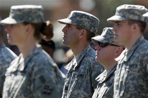 In this Friday, Oct. 3, 2008 file photo, Delaware Attorney General Beau Biden, center, stands with other members of his Delaware Army National Guard unit during a deployment ceremony in Dover, Del. before heading to Iraq. On Saturday, May 30, 2015, Vice P