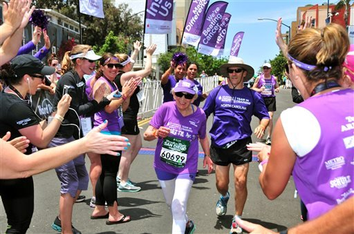 In this June 1, 2014 photo, Harriette Thompson, then 91, crosses the finish line in the 2014 Suja Rock 'n' Roll Marathon in San Diego. Thompson is scheduled to compete in the 2015 edition in San Diego on Sunday, May 31, 2015. If she completes the race she