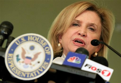 In this April 6, 2012 file photo, Rep. Carolyn Maloney, D-NY, addresses a gathering of Indonesian immigrants at the Reformed Church of Highland Park in Highland Park, N.J. More than 130 suspected Nazi war criminals, SS guards and others who may have parti