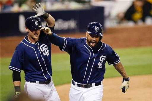 San Diego Padres' Matt Kemp, right, reacts with teammate Will Middlebrooks, as he scores after San Diego Padres' Cory Spangenberg reached on a throwing error by Pittsburgh Pirates first baseman Pedro Alvarez during the fourth inning a baseball game Saturd