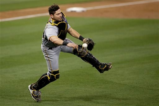 Pittsburgh Pirates catcher Francisco Cervelli throws to first for the out on San Diego Padres' Yangervis Solarte during the third inning of a baseball game Saturday, May 30, 2015, in San Diego. (AP Photo/Gregory Bull)