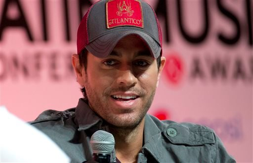 In this April 23, 2014 file photo, Enrique Iglesias talks about his music during a Billboard Latin Music Conference Superstar Q&A session in Miami. Iglesias is recovering after his fingers were sliced when he grabbed a drone during a concert in Tijuana, M