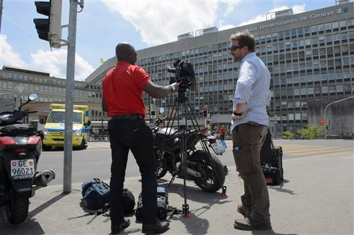 A TV team is waiting in front of Geneva's General Hospital in Geneva, Switzerland, Sunday, May 31, 2015. U.S. Secretary of State John Kerry broke his leg in bike crash outside of Geneva on Sunday and called off the rest of a four-nation diplomatic trip th