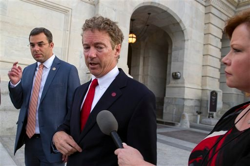 Sen. Rand Paul, R-Ky., talks with a reporter as he leaves the Capitol following his address to the Senate in Washington, Sunday, May 31, 2015. The Senate was unable to make a deal to extend contested anti-terror provisions and as a result, the post-Sept.