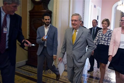 Senate Majority Leader Mitch McConnell, R-Ky., walks to the Senate Chamber to begin a special session to extend surveillance programs, in Washington, Sunday, May 31, 2015. The Senate was unable to make a deal to extend contested anti-terror provisions and
