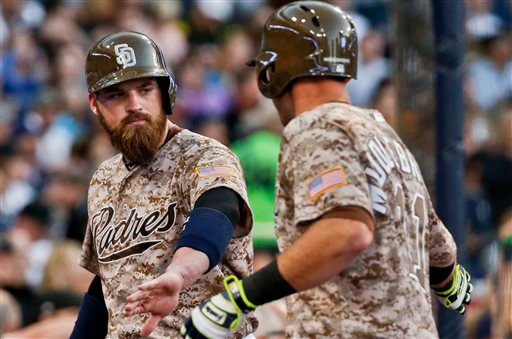 San Diego Padres' Derek Norris congratulates Will Middlebrooks after scoring on MIddlebrooks' sacrifice fly in the fourth inning of a baseball game against the Pittsburgh Pirates on Sunday, May 31, 2015, in San Diego. (AP Photo/Lenny Ignelzi)