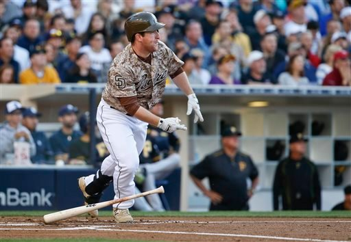 San Diego Padres' Jedd Gyorko watches his bloop single fall in center field and bring in two runs against the Pittsburgh Pirates during the first inning of a baseball game Sunday, May 31, 2015, in San Diego. (AP Photo/Lenny Ignelzi)
