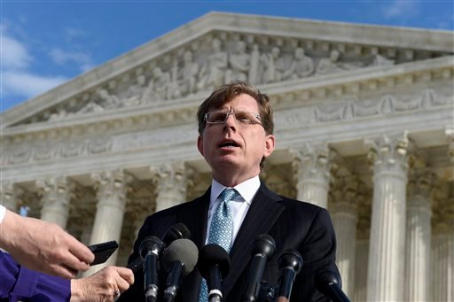 when he posted a series of graphically violent rap lyrics on Facebook about killing his estranged wife, shooting up a kindergarten class and attacking an FBI agent, speaks to reporters outside the Supreme Court in Washington. The Supreme Court on Monday