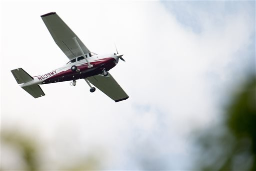 In this photo taken May 26, 2015, a small plane flies near Manassas Regional Airport in Manassas, Va. The plane is among a fleet of surveillance aircraft by the FBI, which are primarily used to target suspects under federal investigation. Such planes are