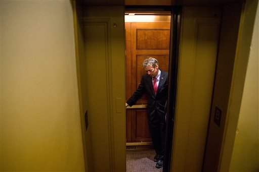 Republican presidential candidate, Sen. Rand Paul, R-Ky. departs in an elevator after speaking at a news conference on Capitol Hill in Washington, Tuesday, June 2, 2015, calling for the 28 classified pages of the 9-11 report to be declassified. Paul has b
