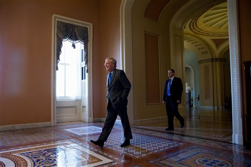 Senate Majority Leader Mitch McConnell of Ky. arrives on Capitol Hill in Washington, Monday, June 1, 2015, before debate continues in the Senate on renewing the Patriot Act. (AP Photo/Andrew Harnik)