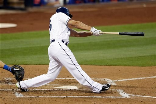 San Diego Padres' Will Venable hits a two-run triple against the New York Mets during the second inning of a baseball game Tuesday, June 2, 2015, in San Diego. (AP Photo/Gregory Bull)