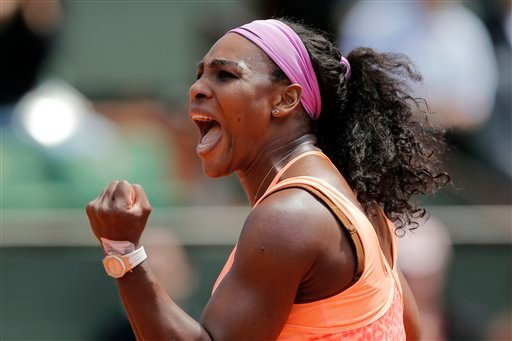 Serena Williams of the U.S. clenches her fist after scoring a point in the quarterfinal match of the French Open tennis tournament against Italy's Sara Errani at the Roland Garros stadium, in Paris, France June 3, 2015.(AP Photo/Christophe Ena)