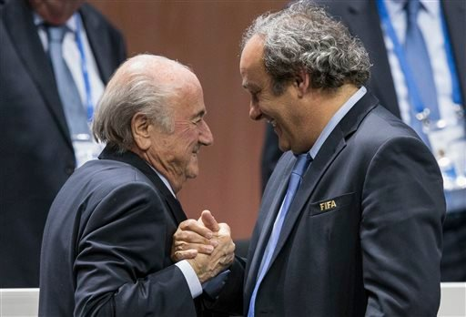 Friday, May 29, 2015 file photo: FIFA president Sepp Blatter after his election as President greeted by UEFA President Michel Platini, right, at the Hallenstadion in Zurich, Switzerland. (Patrick B. Kraemer/Keystone via AP, File)