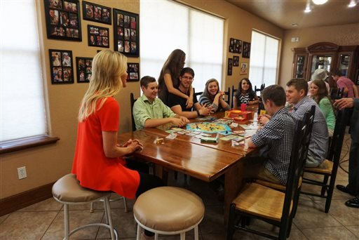 """This photo provided by FOX News shows, FOX News Channel's Megyn Kelly sitting down with the Duggar children of the TLC program """"19 Kids and Counting,"""" June 3, 2015. (FOX News via AP)"""