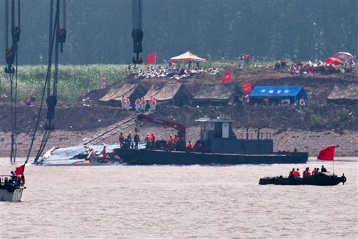 Rescuers prepare near the capsized ship Eastern Star after it was righted by cranes on the Yangtze River in Jianli county of southern China's Hubei province, as seen from across the river from Huarong county of southern China's Hunan province, Friday, Jun