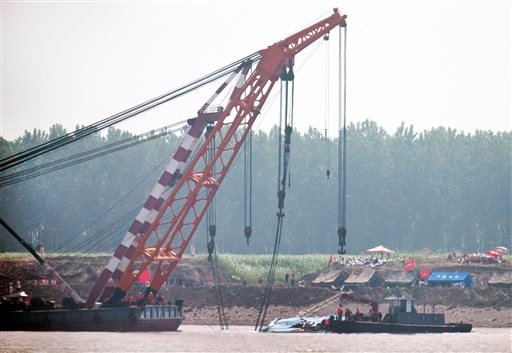 Rescuers prepare near the capsized Eastern Star after it was righted by cranes on the Yangtze River in Jianli county of southern China's Hubei province, as seen from across the river from Huarong county of southern China's Hunan province, Friday, June 5,