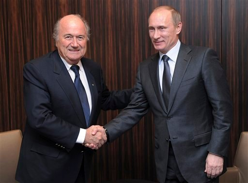 Russian Prime Minister Vladimir Putin, right, shakes hands with FIFA President Joseph Blatter after Russia was announced as the host for the 2018 soccer World Cup in Zurich, Switzerland. FIFA has been plunged into crisis since seven officials were arreste