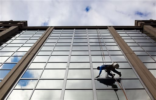 In this April 23, 2015 file photo, a window washer cleans the windows of an office building in downtown Washington. The U.S. government issues the May jobs report on Friday, June 5, 2015. (AP Photo/Pablo Martinez Monsivais, File