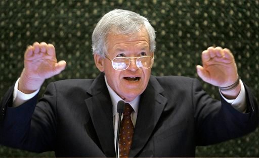 In this March 5, 2008, file photo, former U.S. House Speaker Dennis Hastert speaks to lawmakers on the Illinois House of Representatives floor at the state Capitol in Springfield, Ill. A federal judge on Tuesday delayed former U.S. House Speaker Dennis Ha