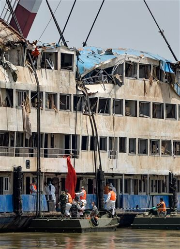 In this photo released by China's Xinhua News Agency, rescuers work in the hull of the upright Eastern Star ship to launch rescue work in the section of Jianli on the Yangtze River, central China's Hubei Province Saturday, June 6, 2015. Disaster teams sta