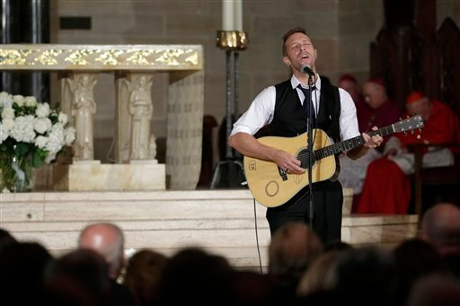 """Chris Martin on the group Coldplay performs """"Til Kingdom Comes"""" during funeral services for Vice President Joe Biden's son, former Delaware Attorney General Beau Biden, Saturday, June 6, 2015, at St. Anthony of Padua Church in Wilmington, Del. Vice Presid"""
