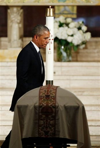 President Barack Obama walks past the casket of Vice President Joe Biden's son, Beau after delivering the eulogy, Saturday, June 6, 2015, at St. Anthony of Padua Church in Wilmington, Del. (Kevin Lamarque/Pool Photo via AP)