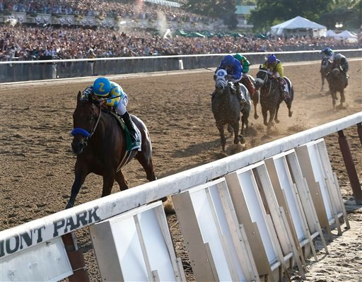 American Pharoah (5) with Victor Espinoza up leads the pack as he approaches the finish line during the 147th running of the Belmont Stakes horse race at Belmont Park, Saturday, June 6, 2015, in Elmont, N.Y. American Pharoah won to be the first horse to w