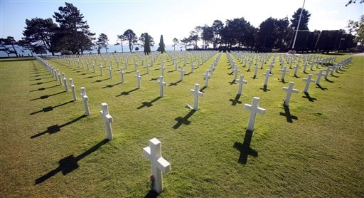 Tombs at the Colleville American military cemetery, in Colleville sur Mer, western France, Saturday June 6, 2015, on the 71st anniversary of the D-Day landing. D-Day marked the start of a Europe invasion, as many thousands of Allied troops began landing o
