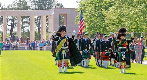 A bagpipe band perform duties at the Colleville American military cemetery, in Colleville sur Mer, western France, Saturday June 6, 2015, as part of the commemoration of the 71st anniversary of the D-Day landing. D-Day marked the start of a Europe invasio