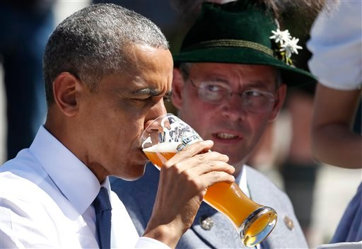 U.S. President Barack Obama drinks a beer during a visit to the village of Kruen, southern Germany, Sunday, June 7, 2015 prior to the G-7 summit in Schloss Elmau hotel near Garmisch-Partenkirchen where the summit will start later the day. (AP Photo/Markus