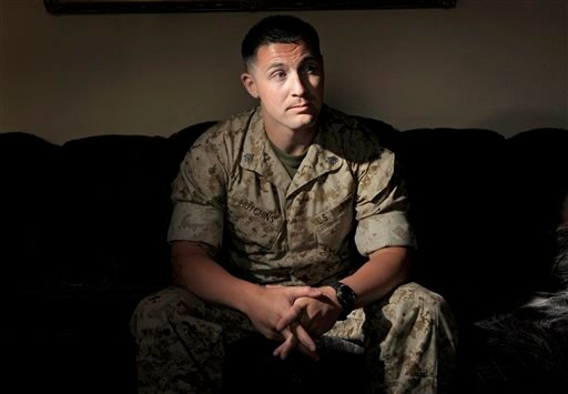 In this June 29, 2010 file photo, U.S. Marine Sergeant Lawrence Hutchins III poses for a portrait in Oceanside, Calif. A third retrial is set to begin for Hutchins, convicted in a high-profile court martial case for the 2006 killing of an Iraqi civilian.