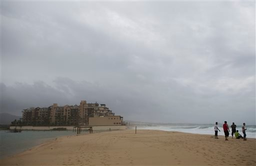 People watch the sea at El Medano Beach before the arrival of Hurricane Blanca, in Cabo San Lucas, Mexico, Sunday June 7, 2015. The unpredictable storm strengthened rapidly to a Category 4 storm on Saturday, but the U.S. National Hurricane Center says it