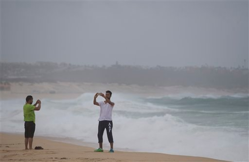 A man takes a selfie at El Medano Beach before the arrival of Hurricane Blanca, in Cabo San Lucas, Mexico, Sunday June 7, 2015. The unpredictable storm strengthened rapidly to a Category 4 storm on Saturday, but the U.S. National Hurricane Center says it