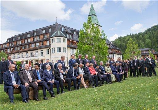 Participants of the G-7 summit crowd in front of Schloss Elmau hotel in Elmau, near Garmisch-Partenkirchen, Germany, Monday June 8, 2015. ( Michael Kappeler/Pool Photo via AP)