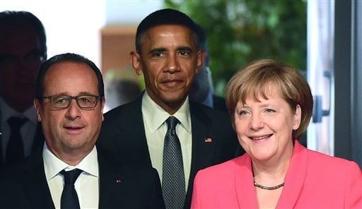 French President Francois Hollande, US President Barack Obama and Germany's Chancellor Angela Merkel, from left, arrive for a working session of the G-7 summit at Schloss Elmau hotel near Garmisch-Partenkirchen, southern Germany, Monday June 8, 2015. (Joh