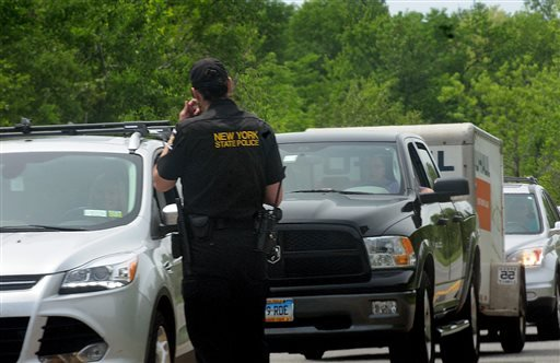 Law enforcement officers search for two escaped prisoners Sunday, June 7, 2015, near Dannemora, N.Y. The two murderers who used power tools to escape from prison must have taken days to cut through steel walls and pipes and break through the bricks at the