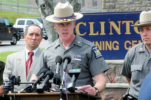 Charles Guest of the New York State Police speaks during a news conference as law enforcement officers search for two escaped prisoners Sunday, June 7, 2015, in Dannemora, N.Y. The two murderers who used power tools to escape from prison must have taken d