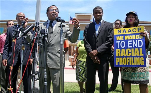 Pastor Ronald Wright, middle, speaks during a news conference outside the McKinney Police Department headquarters, Monday, June 8, 2015, in McKinney, Texas. A McKinney police officer has been placed on leave after a video showed him pushing a 14-year-old