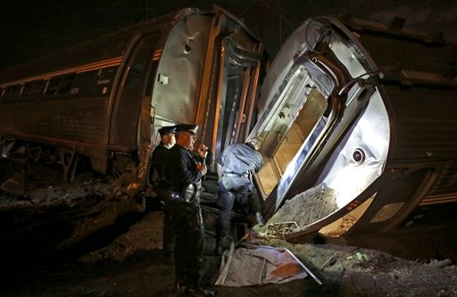 May 12, 2015 file photo: Emergency personnel work the scene of a train wreck in Philadelphia. An Amtrak train headed to New York City derailed and crashed in Philadelphia. (AP Photo/Joseph Kaczmarek, File)