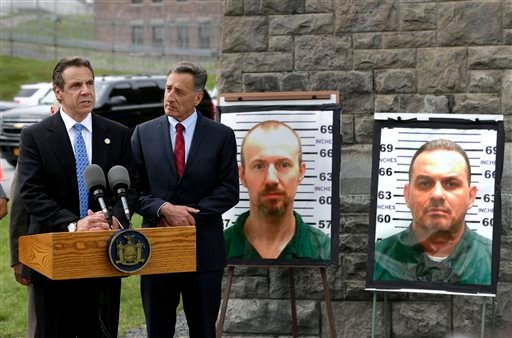 NY Governor Andrew Cuomo, left, speaks while Vermont Governor Peter Shumlin listens during a news conference in front of the Clinton Correctional Facility in Dannemora, N.Y. June 10, 2015. (AP Photo/Seth Wenig)