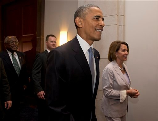 President Barack Obama, House Minority Leader Nancy Pelosi of Calif. and House Minority Assistant Leader James Clyburn of S.C., leave meeting with House Democrats on Capitol Hill in Washington, Friday, June 12, 2015. The president made an 11th-hour appeal