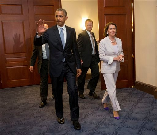 President Barack Obama and House Minority Leader Nancy Pelosi of Calif. leave meeting with House Democrats on Capitol Hill in Washington, Friday, June 12, 2015. The president made an 11th-hour appeal to dubious Democrats on Friday in a tense run-up to a H