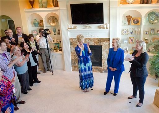 Democratic presidential candidate Hillary Rodham Clinton greets supporters during a campaign house party in Sioux City, Iowa, Saturday, June 13, 2015. (Justin Wan/The Sioux City Journal via AP