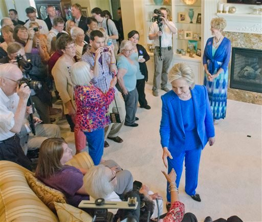Democratic presidential hopeful, former Secretary of State Hillary Rodham Clinton, greets a supporter during a campaign house party Saturday, June 13, 2015, in Sioux City, Iowa. (Justin Wan/The Sioux City Journal via AP)
