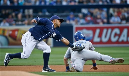 San Diego Padres shortstop Alexi Amarista, left, tags out Los Angeles Dodgers' Joc Pederson to end the first inning with a double play in a baseball game Saturday, June 13, 2015, in San Diego. (AP Photo/Lenny Ignelzi)